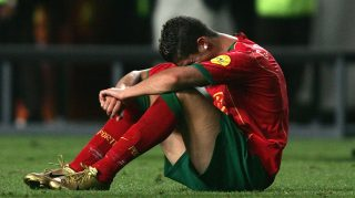 LISBON, PORTUGAL - JULY 4: Cristiano Ronaldo of Portugal in tears after the UEFA Euro 2004, Final match between Portugal and Greece at the Luz Stadium on July 4, 2004 in Lisbon, Portugal. (Photo by Ben Radford/Getty Images) *** Local Caption *** Cristiano Ronaldo