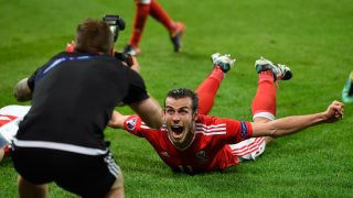 LILLE, FRANCE - JULY 01: Wales player Gareth Bale celebrates after the UEFA Euro 2016 Quarter Final match between Wales and Belguim at Stade Pierre-Mauroy on July 1, 2016 in Lille, France. (Photo by Stu Forster/Getty Images)