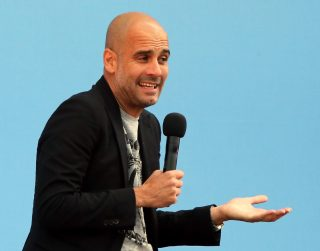 MANCHESTER, ENGLAND - JULY 03: Manchester City's new Manager Pep Guardiola (L) is unveiled during a media day at the Etihad campus on July 3, 2016 in Manchester, England. (Photo by Nigel Roddis/Getty Images)