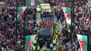 CARDIFF, UNITED KINGDOM - JULY 08: The Wales Football squad head down St Mary's street on their bus parade around Cardiff on their EURO 2016 homecoming tour on July 8, 2016 in Cardiff, Wales. (Photo by Stu Forster/Getty Images)