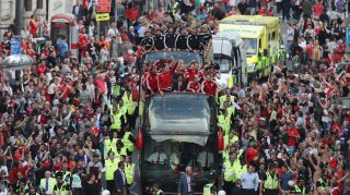 CARDIFF, WALES - JULY 08: Fans cheer as they line Westgate Street to welcome the Wales team home following their exit from the Euro 2016 championships, on July 8, 2016 in Cardiff, Wales. Wales' fairytale run ended on Wednesday after they were beaten 2-0 by Portugal in their Euro 2016 semi-final match (Photo by Matt Cardy/Getty Images)
