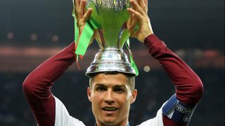 PARIS, FRANCE - JULY 10: Cristiano Ronaldo of Portugal holds the Henri Delaunay trophy to celebrate after his team's 1-0 win against France in the UEFA EURO 2016 Final match between Portugal and France at Stade de France on July 10, 2016 in Paris, France. (Photo by Matthias Hangst/Getty Images)