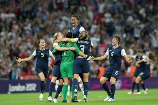 LONDON, ENGLAND - AUGUST 09: Hope Solo #1, Shannon Boxx #7 and Christie Rampone #3, Amy LePeilbet #6, Kelley O'Hara #5 of the United States celebrates after defeating Japan by a score of 2-1 to win the Women's Football gold medal match on Day 13 of the London 2012 Olympic Games at Wembley Stadium on August 9, 2012 in London, England. (Photo by Ronald Martinez/Getty Images)