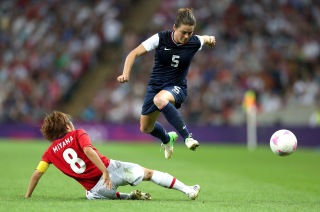 LONDON, ENGLAND - AUGUST 09: Kelley O'Hara #5 of United States moves the ball against Aya Miyama #8 of Japan in the second half during the Women's Football gold medal match on Day 13 of the London 2012 Olympic Games at Wembley Stadium on August 9, 2012 in London, England. (Photo by Julian Finney/Getty Images)