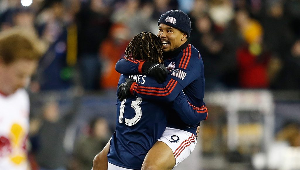 FOXBORO, MA - NOVEMBER 29: Jermaine Jones #13 of New England Revolution celebrates with Charlie Davies after they won the MLS Eastern Conference Championship as the the New York Red Bulls leave the field at Gillette Stadium on November 29, 2014 in Foxboro, Massachusetts. (Photo by Jim Rogash/Getty Images)