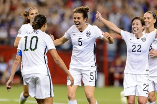 MONTREAL, QC - JUNE 30: Kelley O'Hara #5 of the United States celebrates with teammates after scoring a goal in the second half against Germany in the FIFA Women's World Cup 2015 Semi-Final Match at Olympic Stadium on June 30, 2015 in Montreal, Canada. (Photo by Minas Panagiotakis/Getty Images)
