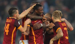 ROME, ITALY - DECEMBER 20: Umar Sadiq (C) with his teammates of AS Roma celebrates after scoring the team's second goal during the Serie A match between AS Roma and Genoa CFC at Stadio Olimpico on December 20, 2015 in Rome, Italy. (Photo by Paolo Bruno/Getty Images)