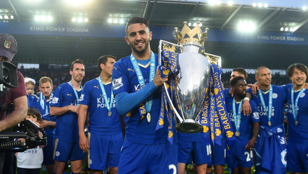 LEICESTER, ENGLAND - MAY 07: Riyad Mahrez of Leicester City poses with the Premier League Trophy as players and staffs celebrate the season champion after the Barclays Premier League match between Leicester City and Everton at The King Power Stadium on May 7, 2016 in Leicester, United Kingdom. (Photo by Michael Regan/Getty Images)