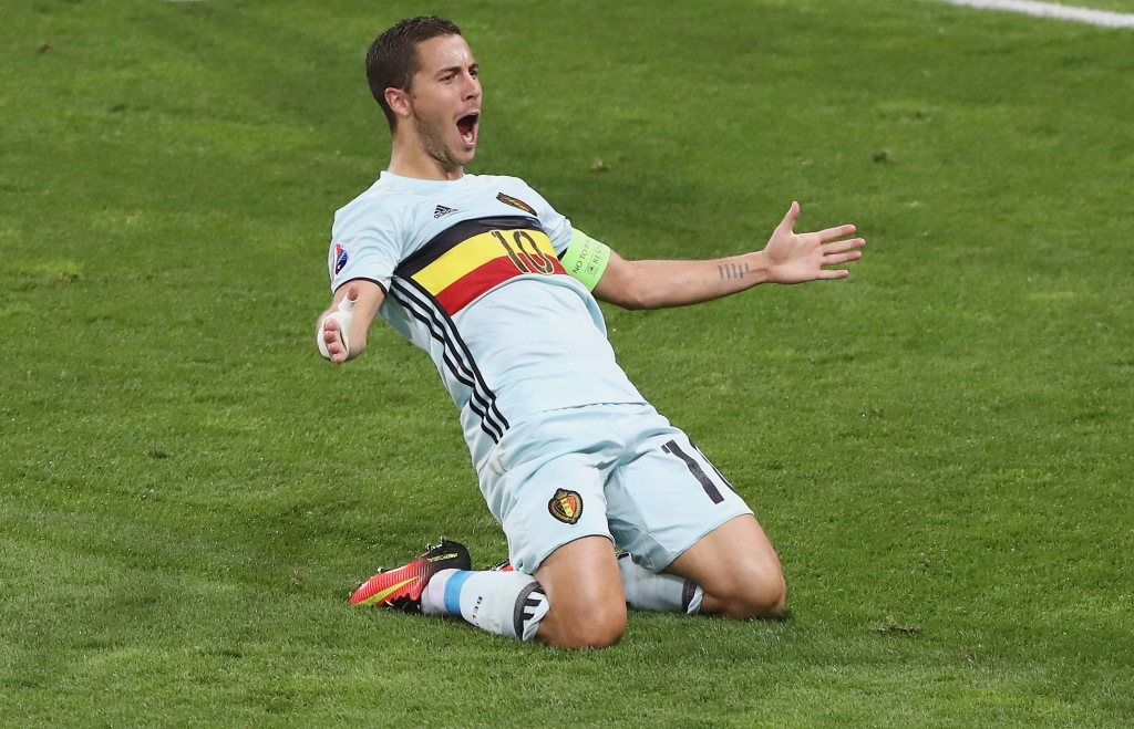 TOULOUSE, FRANCE - JUNE 26: Eden Hazard of Belgium slides on his knees as he celebrates scoring his team's third goal during the UEFA EURO 2016 round of 16 match between Hungary and Belgium at Stadium Municipal on June 26, 2016 in Toulouse, France. (Photo by Dean Mouhtaropoulos/Getty Images)