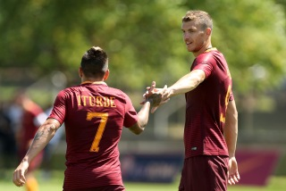 CAMBRIDGE, MA - JULY 27: Juan Manuel Iturbe #7 of AS Roma celebrates a goal with Edin Dzeko #9 during a friendly match against the Boston Bolts at Ohiri Field on July 27, 2016 in Cambridge, Massachusetts. (Photo by Mike Lawrie/Getty Images)