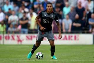 OLDENZAAL, NETHERLANDS - JULY 27: Virgil van Dijk of Southampton runs with the ball during the friendly match between Twente Enschede and FC Southampton at Q20 Stadium on July 27, 2016 in Oldenzaal, Netherlands. (Photo by Christof Koepsel/Getty Images)
