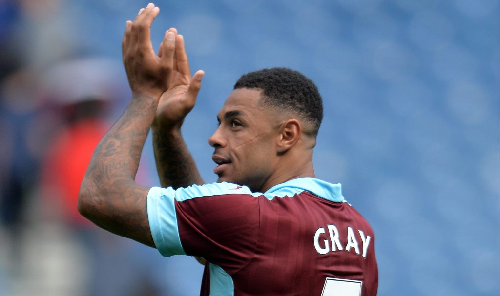 GLASGOW, SCOTLAND - JULY 30: Andre Gray applauds the traveling Burnley fans during a pre-season friendly between Rangers FC and Burnley FC at Ibrox Stadium on July 30, 2016 in Glasgow, Scotland. (Photo by Mark Runnacles/Getty Images)