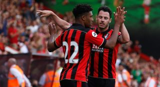 BOURNEMOUTH, ENGLAND - JULY 30: Jordan Ibe of Bournemouth is congratulated by team mate Adam Smith after scoring during a pre-season match between Bournemouth and Cardiff City at Goldsands Stadium on July 30, 2016 in Bournemouth, England. (Photo by Joel Ford/Getty Images)