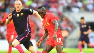 LONDON, ENGLAND - AUGUST 06: Sadio Mane of Liverpool is closed down by Jeremy Mathieu of Barcelona during the International Champions Cup match between Liverpool and Barcelona at Wembley Stadium on August 6, 2016 in London, England. (Photo by Michael Regan/Getty Images)