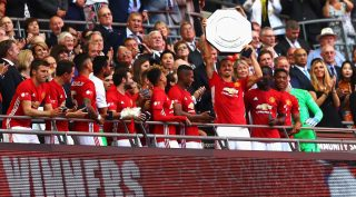 LONDON, ENGLAND - AUGUST 07: Zlatan Ibrahimovic of Manchester United celebrates with his team mates after he lifts the Community Shield during The FA Community Shield match between Leicester City and Manchester United at Wembley Stadium on August 7, 2016 in London, England. (Photo by Michael Steele/Getty Images)