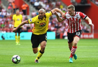 SOUTHAMPTON, ENGLAND - AUGUST 13: Nordin Amrabat of Watford battle for possession with sMatt Targett of Southampton during the Premier League match between Southampton and Watford at St Mary's Stadium on August 13, 2016 in Southampton, England.  (Photo by Mike Hewitt/Getty Images)