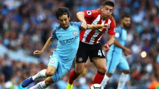 MANCHESTER, ENGLAND - AUGUST 13: Lynden Gooch of Sunderland challenges David Silva of Manchester City during the Premier League match between Manchester City and Sunderland at Etihad Stadium on August 13, 2016 in Manchester, England. (Photo by Michael Steele/Getty Images)