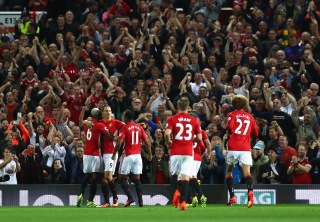 MANCHESTER, ENGLAND - AUGUST 19: Zlatan Ibrahimovic of Manchester United celebrates scoring his team's second goal from the penalty spot during the Premier League match between Manchester United and Southampton at Old Trafford on August 19, 2016 in Manchester, England. (Photo by Michael Steele/Getty Images)