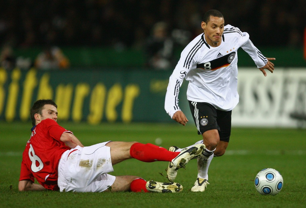 BERLIN - NOVEMBER 19: Jermaine Jones of Germany moves away from the challenge of Michael Carrick of England during the International Friendly match between Germany and England at the Olympic Stadium on November 19, 2008 in Berlin, Germany. (Photo by Alex Livesey/Getty Images)
