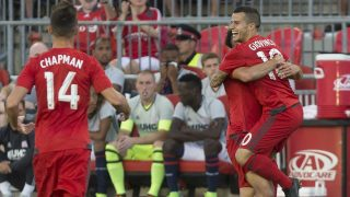 Toronto FC's Sebastian Giovinco, right, celebrates after scoring his team's second goal against the New England Revolution during first-half MLS soccer game action in Toronto, Saturday, Aug. 6, 2016. (Chris Young/The Canadian Press via AP)