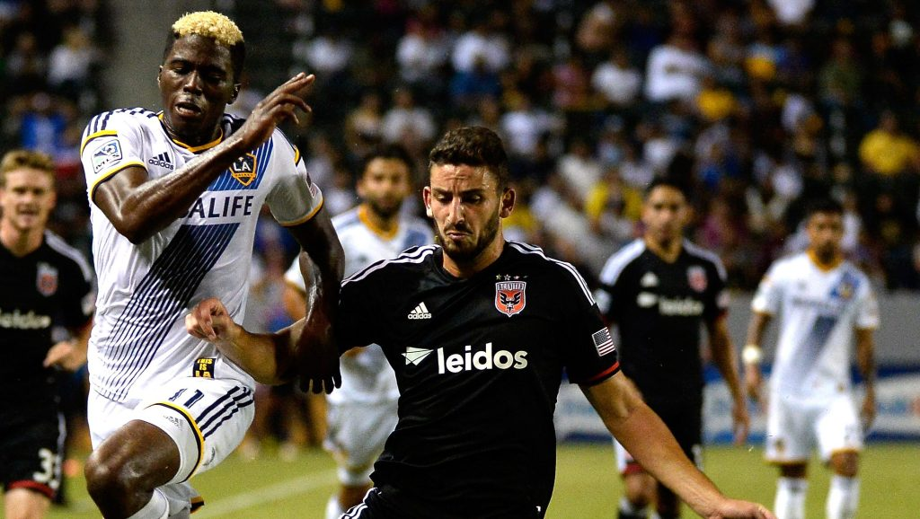 LOS ANGELES, CA - AUGUST 27: Gyasi Zardes #11 of the Los Angeles Galaxy and Steve Birnbaum #15 of D.C. United chase after a ball during the second half against D.C United at StubHub Center on August 27, 2014 in Los Angeles, California. (Photo by Harry How/Getty Images)