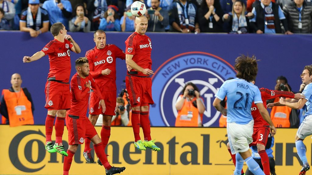 NEW YORK, NY - MARCH 13: Benoit Cheyrou #8 of Toronto FC defends Andrea Pirlo #21 of New York City FC free kick at Yankee Stadium on March 13, 2016 in the Bronx borough of New York City. (Photo by Mike Stobe/Getty Images)