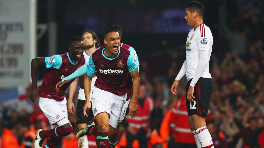 LONDON, ENGLAND - MAY 10: Chris Smalling of Manchester United looks dejected as Winston Reid of West Ham United celebrates as he scores their third goal during the Barclays Premier League match between West Ham United and Manchester United at the Boleyn Ground on May 10, 2016 in London, England. West Ham United are playing their last ever home match at the Boleyn Ground after their 112 year stay at the stadium. The Hammers will move to the Olympic Stadium for the 2016-17 season. (Photo by Julian Finney/Getty Images)
