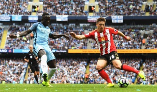 MANCHESTER, ENGLAND - AUGUST 13: Bacary Sagna of Manchester City (L) attempts to black Lynden Gooch of Sunderland (R) shot during the Premier League match between Manchester City and Sunderland at Etihad Stadium on August 13, 2016 in Manchester, England. (Photo by Stu Forster/Getty Images)