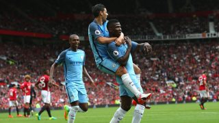 MANCHESTER, ENGLAND - SEPTEMBER 10:  Kelechi Iheanacho (R) of Manchester City celebrates scoring his sides second goal while team mate Nolito (C) of Manchester City jumps on his back during the Premier League match between Manchester United and Manchester City at Old Trafford on September 10, 2016 in Manchester, England.  (Photo by Alex Livesey/Getty Images)