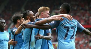 MANCHESTER, ENGLAND - SEPTEMBER 10: Kelechi Iheanacho of Manchester City (R) celebrates scoring his sides second goal with his Manchester City team mates during the Premier League match between Manchester United and Manchester City at Old Trafford on September 10, 2016 in Manchester, England. (Photo by Alex Livesey/Getty Images)