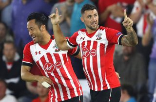 SOUTHAMPTON, ENGLAND - SEPTEMBER 15: Charlie Austin of Southampton celebrates scoring his teams opener with teammate Maya Yoshida during the UEFA Europa League Group K match between Southampton FC and AC Sparta Praha at St Mary's Stadium on September 15, 2016 in Southampton, England. (Photo by Warren Little/Getty Images)