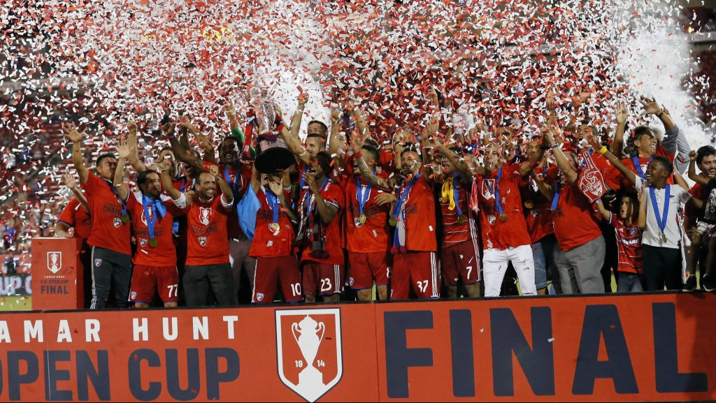 FC Dallas celebrates its 4-2 win over the New England Revolution in the U.S. Open Cup soccer final, Tuesday Sept. 13, 2016, in Frisco, Texas. (AP Photo/Tony Gutierrez)