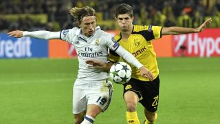 Real Madrid's Luka Modric, left, and Dortmund's Christian Pulisic challenge for the ball during the Champions League group F soccer match between Borussia Dortmund and Real Madrid in Dortmund, Germany, Tuesday, Sept. 27, 2016. (AP Photo/Martin Meissner)