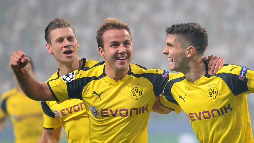 Dortmund's Mario Goetze, center, celebrates with Christian Pulisic, right, after scoring the first goal of his team during the Champions League Group F soccer match between Legia Warsaw and Dortmund at Stadion Wojska Polskiego in Warsaw, Poland, Wednesday, Sept. 14, 2016. (AP Photo/Alik Keplicz)
