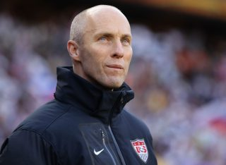 JOHANNESBURG, SOUTH AFRICA - JUNE 18: Bob Bradley head coach of the USA looks thoughtful during the 2010 FIFA World Cup South Africa Group C match between Slovenia and USA at Ellis Park Stadium on June 18, 2010 in Johannesburg, South Africa. (Photo by Ezra Shaw/Getty Images)