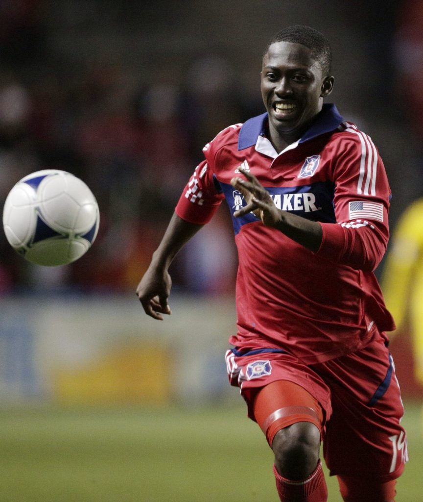 BRIDGEVIEW, IL - SEPTEMBER 22: Patrick Nyarko #14 of the Chicago Fire advances the ball on the Columbus Crew during their MLS soccer match at Toyota Park on September 22, 2012 in Bridgeview, Illinois. The Fire defeated the Crew 2-1. (Photo by John Gress/Getty Images)