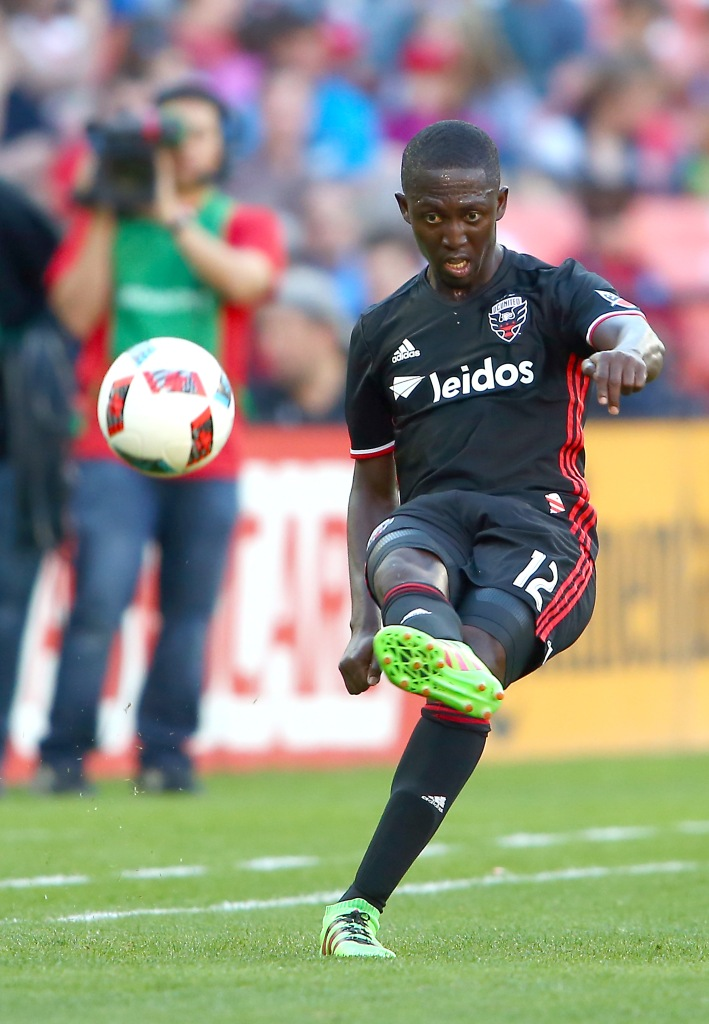 April 23 2016: D.C. United forward Patrick Nyarko (12) makes a long pass during a MLS match at RFK Stadium, in Washington D.C. DC United defeated the New England Revolution 3-0. (Photo by Tony Quinn/Iconsportswire)