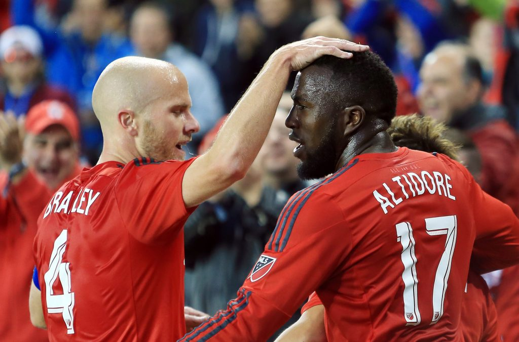 TORONTO, ON - MAY 07: Michael Bradley #4 and Jozy Altidore #17 of Toronto FC celebrate a goal by teammate Tsubasa Endoh #9 during the first half of an MLS soccer game against FC Dallas at BMO Field on May 7, 2016 in Toronto, Ontario, Canada. (Photo by Vaughn Ridley/Getty Images)