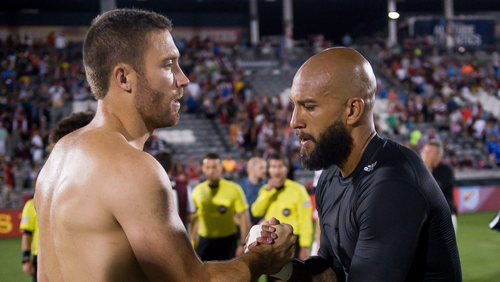 COMMERCE CITY, CO - JULY 23: Tim Howard #1 of the Colorado Rapids and Chris Seitz #18 of FC Dallas exchange jerseys after a game at Dick's Sporting Goods Park on July 23, 2016 in Commerce City, Colorado. (Photo by Dustin Bradford/Getty Images)