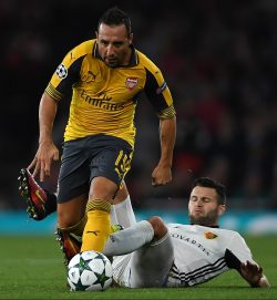 A kick to the heel of Santi Cazorla could leave him on the sidelines against Middlesbrough (Photo by Mike Hewitt/Getty Images).