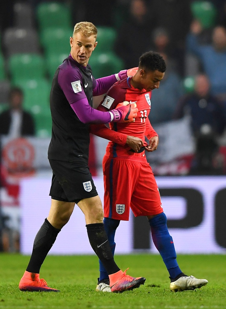 LJUBLJANA, SLOVENIA - OCTOBER 11:  Joe Hart of England speaks with team-mate Jesse Lingard during the FIFA 2018 World Cup Qualifier Group F match between Slovenia and England at Stadion Stozice on October 11, 2016 in Ljubljana, Slovenia.  (Photo by Laurence Griffiths/Getty Images)