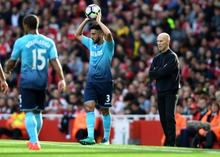 LONDON, ENGLAND - OCTOBER 15: Neil Taylor of Swansea City (C) takes a throw in while Bob Bradley, Manager of Swansea City (R) looks on during the Premier League match between Arsenal and Swansea City at Emirates Stadium on October 15, 2016 in London, England. (Photo by Mike Hewitt/Getty Images)