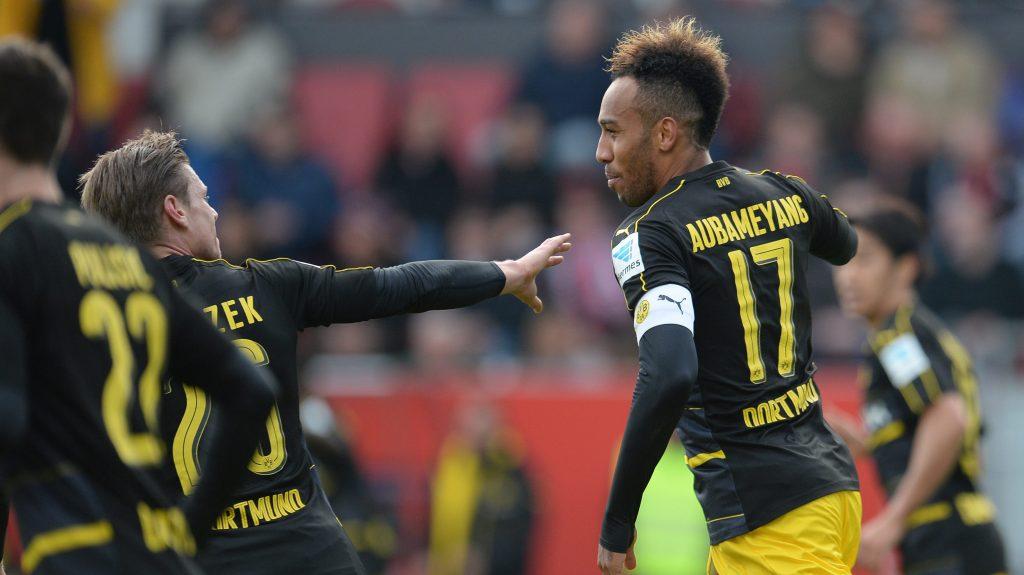 Dortmund's Pierre-Emerick Aubameyang, right, and Lukas Pisczek cheer over  a goal during the German Bundesliga soccer match between FC Ingolstadt 04 and Borussia Dortmund  in Ingolstadt,Germany,  Saturday Oct. 22, 2016. (Andreas Gebert/dpa via AP)