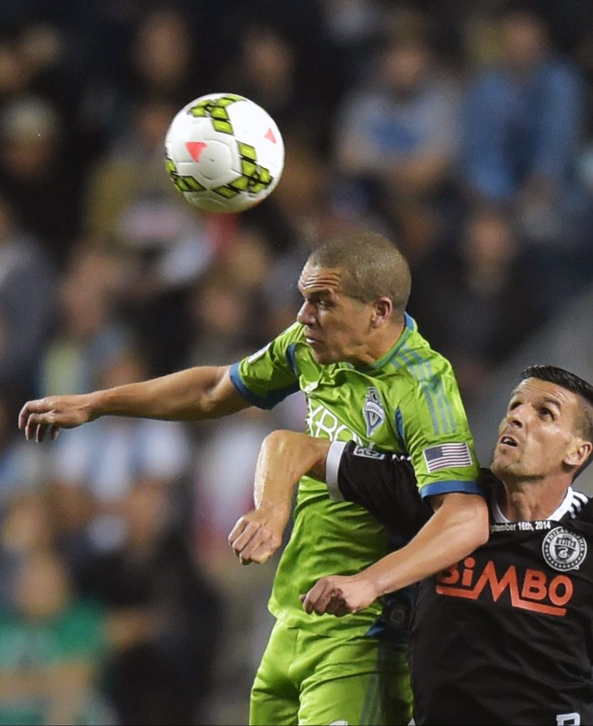 CHESTER, PA - SEPTEMBER 16: Midfielder Osvaldo Alonso #6 of the Seattle Sounders FC heads the ball over forward Sebastien Le Toux #11 of the Philadelphia Union during the 2014 U.S. Open Cup Final at PPL Park on September 16, 2014 in Chester, Pennsylvania. The Sounders won 3-1. (Photo by Drew Hallowell/Getty Images)