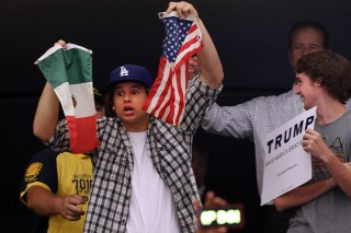 ANAHEIM, CA - MAY 25: A protester is taken away by security from a Donald Trump rally on May 25, 2016 in Anaheim, California. The presumptive Republican presidential candidate is on a Western campaign swing. A rally in Albuquerque, New Mexico turned violent on Tuesday, leading to at least one arrest and several injuries, police say. (Photo by Spencer Platt/Getty Images)