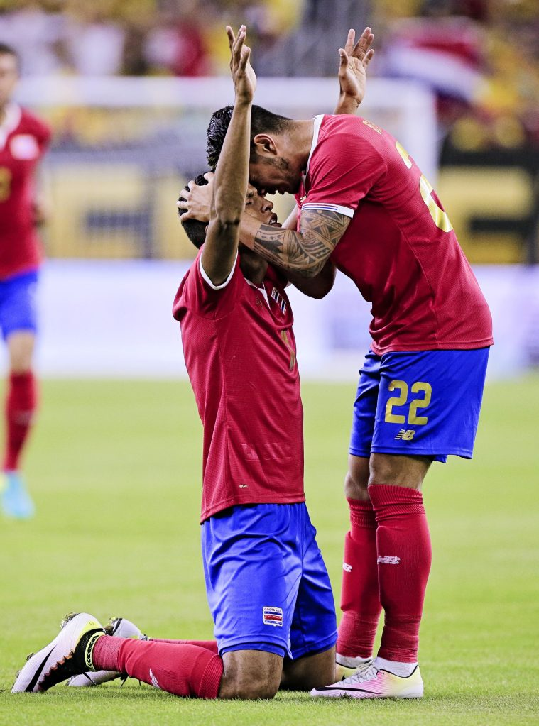 HOUSTON, TX - JUNE 11: Johan Venegas #11 of Costa Rica celebrates with Ronald Matarrita #22 after scoring in game action agaisnt Colombia at NRG Stadium on June 11, 2016 in Houston, Texas. (Photo by Bob Levey/Getty Images)
