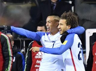 COLUMBUS, OH - NOVEMBER 11: Bobby Wood #7 of the United States celebrates with teammate Fabian Johnson #23 after scoring a second half goal against Mexico during the FIFA 2018 World Cup Qualifier at MAPFRE Stadium on November 11, 2016 in Columbus, Ohio. (Photo by Jamie Sabau/Getty Images)