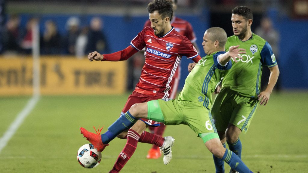 FC Dallas forward Maximiliano Urruti (37) and Seattle Sounders midfielder Osvaldo Alonso (6) compete for a ball along the sidelines during the first half of an MLS soccer western conference semifinal playoff match Sunday, Nov. 6, 2016 in Frisco, Texas. (AP Photo/Jeffrey McWhorter)