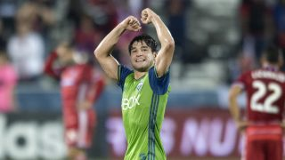Seattle Sounders midfielder Nicolas Lodeiro (10) exults as FC Dallas midfielder Carlos Gruezo (7) lies on the turf at the end of an MLS soccer western conference semifinal playoff match Sunday, Nov. 6, 2016 in Frisco, Texas. Though Dallas won 2-1, Seattle advanced in the playoffs on aggregate score. (AP Photo/Jeffrey McWhorter)