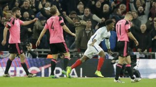 England's Daniel Sturridge, second right, celebrates after scoring his side's first goal as Scotland's Grant Hanley, left, Christophe Berra, second left, and Graham Morrison, right, react during the World Cup group F qualifying soccer match between England and Scotland at the Wembley stadium, London, Friday, Nov. 11, 2016. (AP Photo/Matt Dunham)